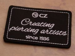 Patch creating piercing artist